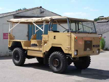 Land Rover 101 FC in sand Canvas with side rolled up